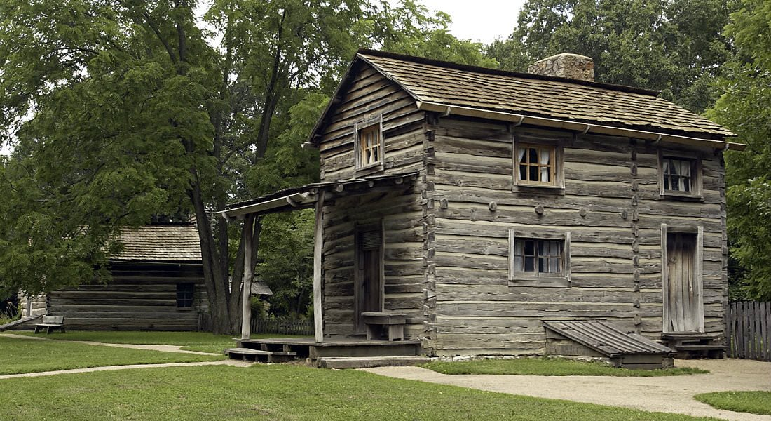 Group of historic log cabins nestled in the woods - New Salem Historic Site