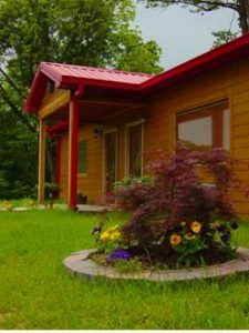 An exterior view of one of the wooden cabins at Boar's Nest B&B.