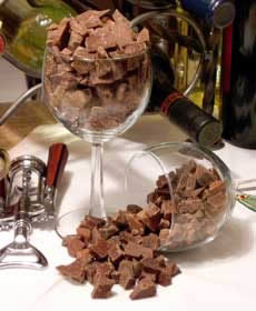 Crystal filled glasses with chocolate from 24 hour chocolate buffet, white wine bottle and corkscrew.